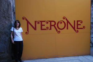 Margaret in front of Nero sign in Rome